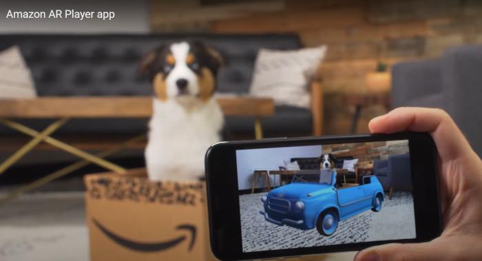 Amazon, Screenshot der App - Hund sitzt in Amazon-Paket