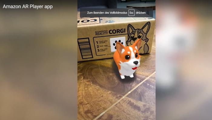 Amazon, Screenshot App - Hund springt aus Karton hervor