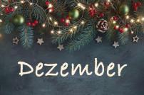 Schriftzug Dezember auf weihnachtlichem Grund