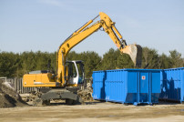 Bagger mit Container