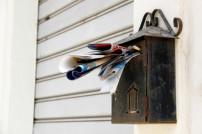 überfüllter Briefkasten